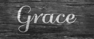 The Word Grace on Barn Wood